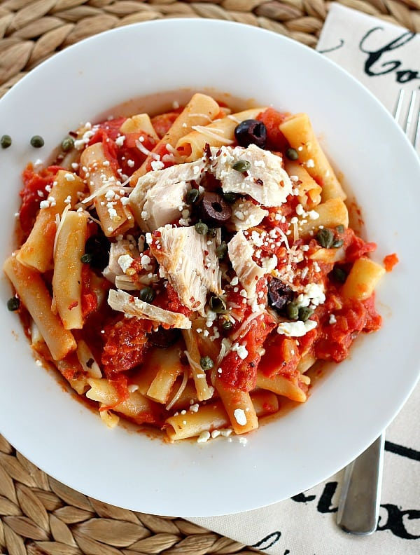 Tuna with Simple Pasta sauce is complex and satisfying. Pasta gets simmered in the sauce for slow-simmer flavor. Two cheeses, red pepper flakes, capers and olives.