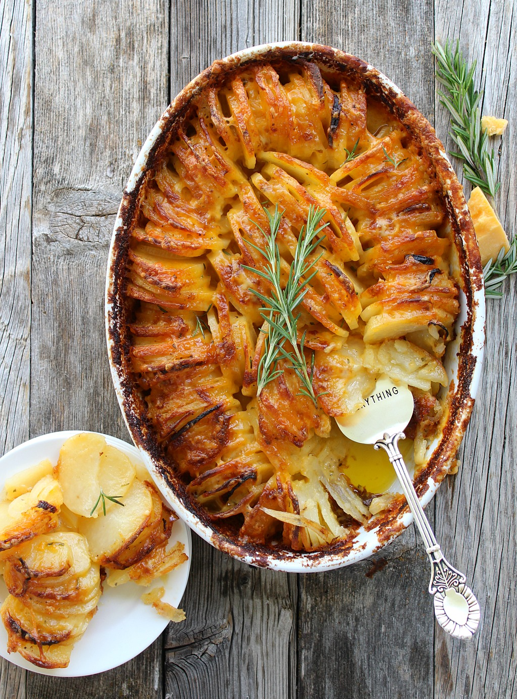 Scalloped potatoes, served Hasselback style are creamy and delicious. Cheddar and Pepper Jack with garlic and rosemary, perfectly soft yet crispy.