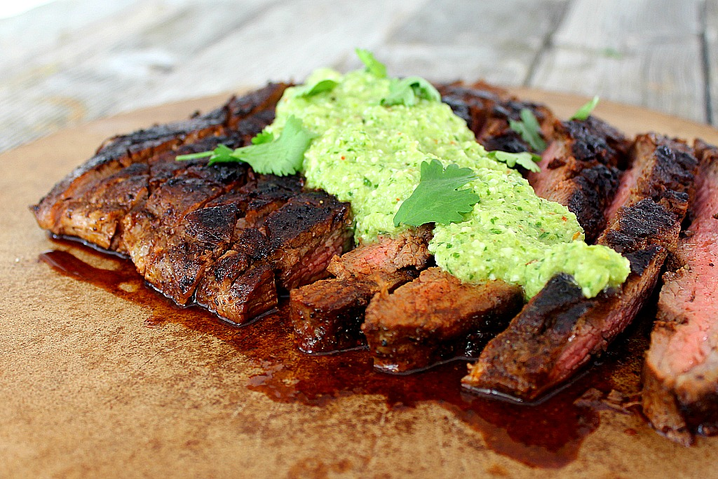 Flank steak with espresso rub and green chile pesto is full of flavor, ready in just 30 minutes. Tender and juicy, guaranteed.