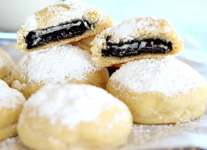 """Oreos are wrapped in crescent dough, sprinkled with powdered sugar and baked in the oven for a very """"cool"""" last minute treat."""