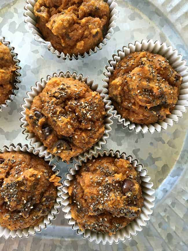These pumpkin muffins are made with dark chocolate, coconut oil, chia seeds and of course, pumpkin puree. Substitute walnuts for the chocolate if desired.