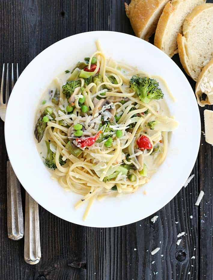 Fresh and on the table in under 30 minutes, One Pot Pasta Primavera mixes vegetables and pasta in a creamy light sauce.
