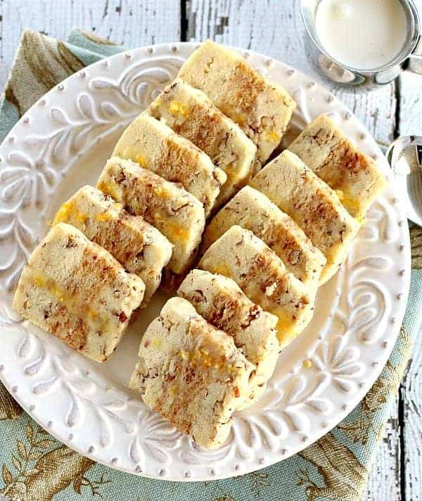 Orange Date Nut Cookies are perfect for serving with coffee or tea. Layers of pecan shortbread, minced dates infused with orange zest and drizzled with glaze.
