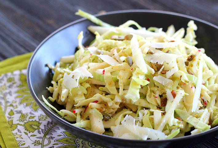 This Asian Pear Cole Slaw recipe is crispy-crunchy good and good-for-you with green cabbage, fennel, radishes, and Asian pear slices. Roasted pumpkin seeds and Manchego complement the Dijon lemon vinaigrette.