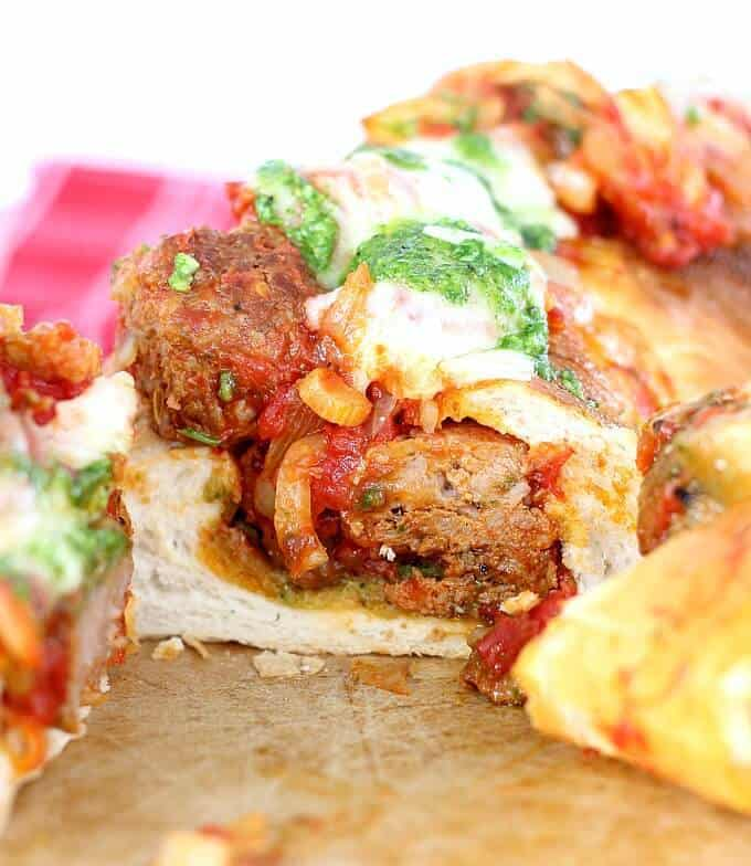 The Best Meatball Sandwich features delicious meatball sauce, serve on French bread with homemade basil paste and melted mozzarella cheese. Amazing!