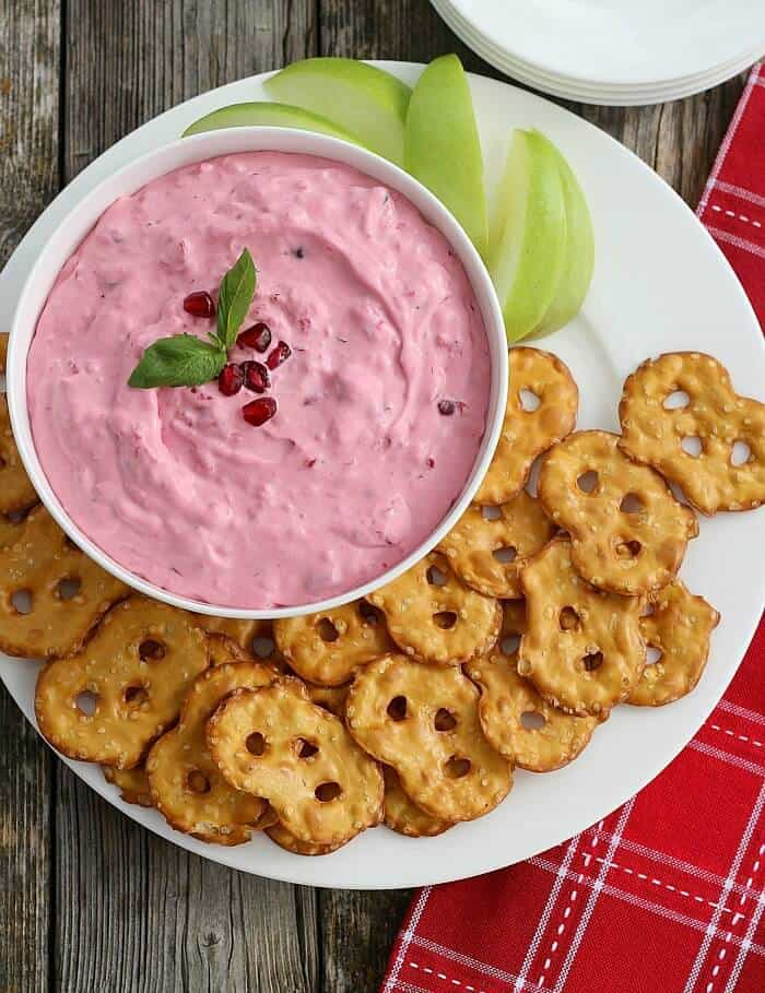 Cranberry Basil Dip combines cranberries, pomegranates, raspberries, and cream cheese, then becomes amazing with the addition of fresh basil.