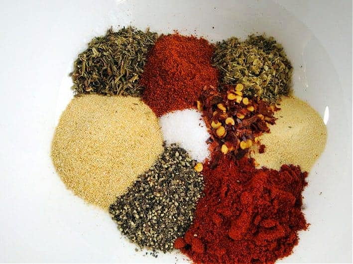cajun spice mix before mixing in white bowl
