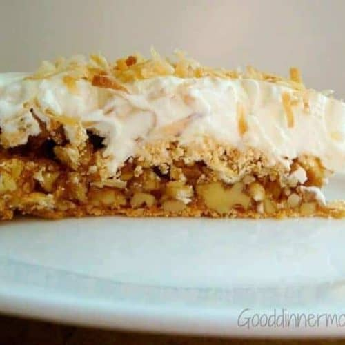 slice of walnut torte with whipped cream topping