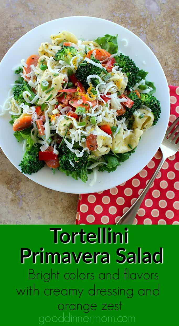 Tortellini Primavera Salad adds fresh vegetables, tortellini and a delicious dressing with orange peel, basil, thyme and mayonnaise. Topped with mozzarella. #pastasalad #tortellini #foodie