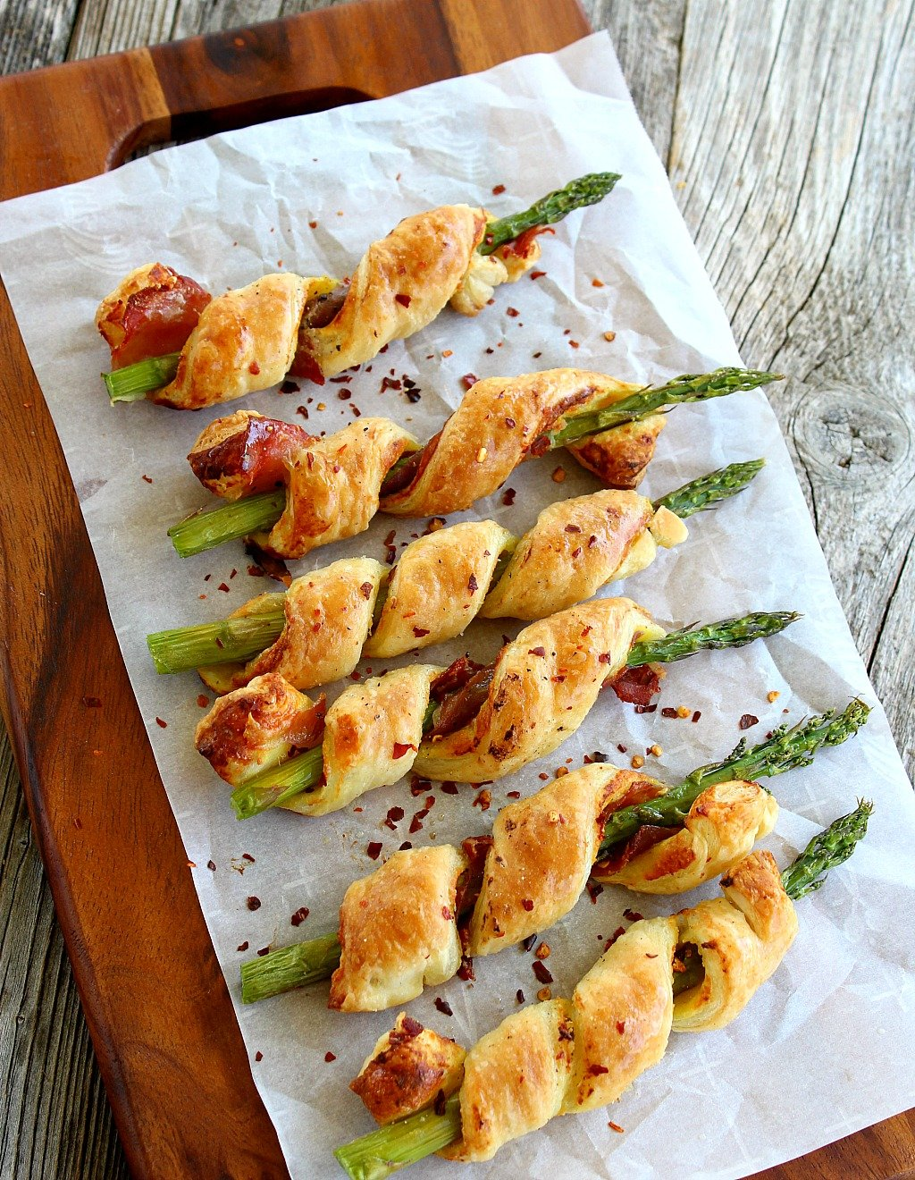 Asparagus, Dijon, Parmesan, and prosciutto, wrapped in puff pastry. Perfect appetizer or fancy side dish; Sprigs in a Blanket are tasty but super easy.