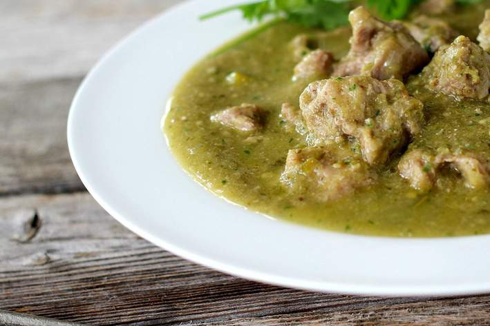 close up of chile verde in white plate