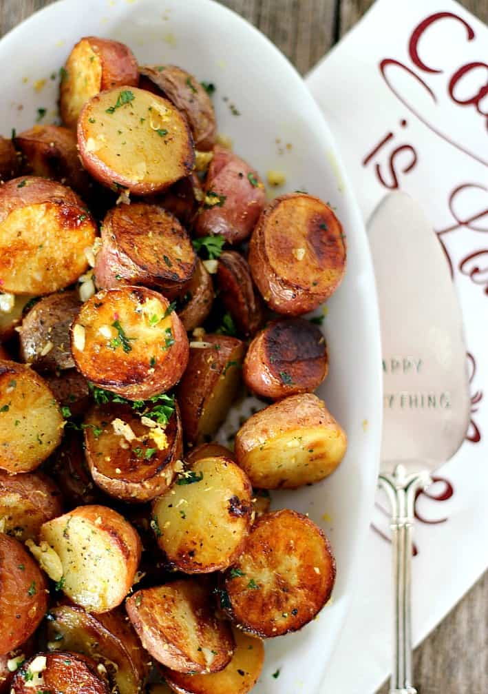 Lemon Garlic Potatoes are impressive but simple. Crispy on the outside, buttery soft inside, like your favorite steak fries, lemon and garlic add a Mediterranean flare.