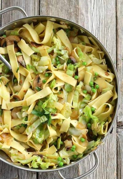 Cabbage and Noodles is a delicious side dish or even meatless main dish. Use your favorite egg noodles or even gluten-free noodles. #haluski #cabbage #pasta #meatlessmain #vegetarianside