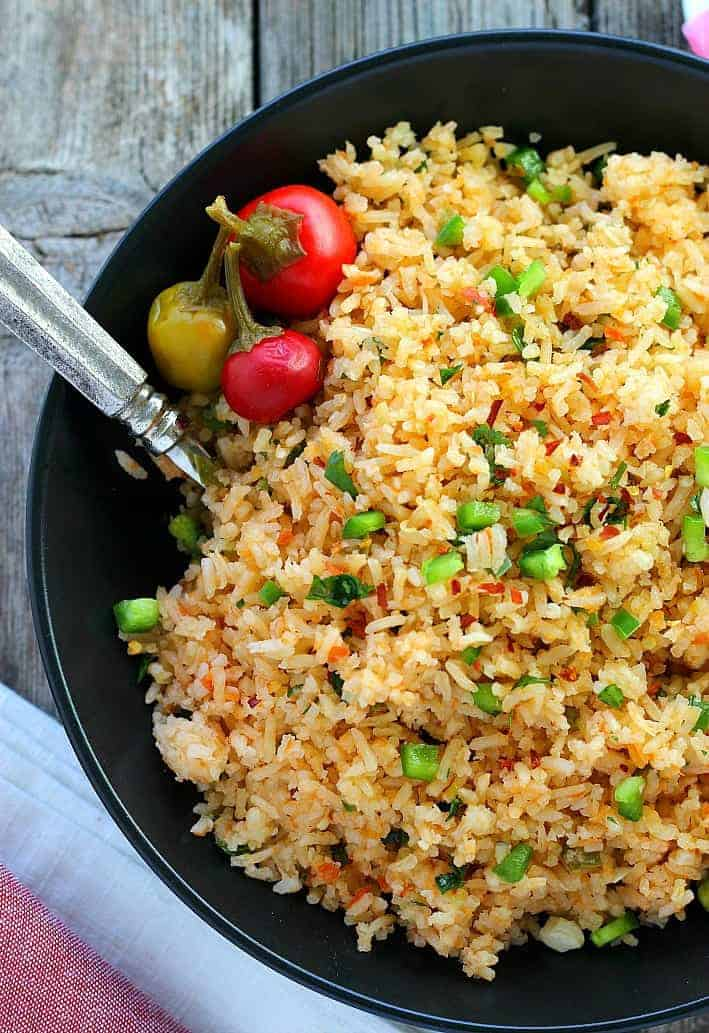 Classic Mexican Rice is traditional and flavorful. Perfect for any Mexican menu, the flavors get even better over time if you want to make it in advance but easy enough to make anytime.