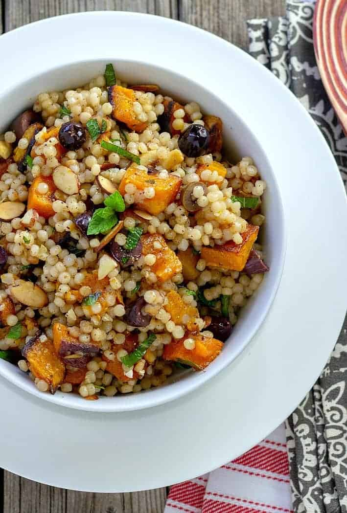 Roasted Butternut Squash and Israeli Couscous Pilaf is a quick, easy Mediterranean dish. Tossed with fresh mint, kalamata olives, and sliced almonds.