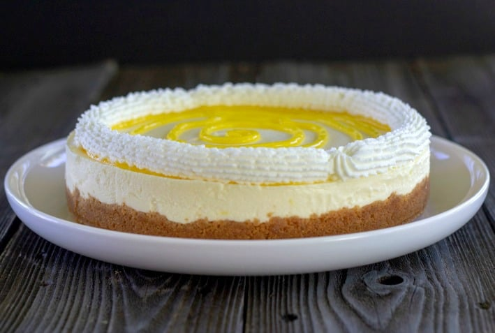 no bake lemon cheesecake on a plate with graham cracker crust