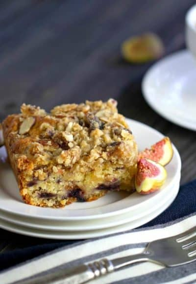 Fig Coffee Cake is moist and melt-in-your-mouth delicious. Fresh figs, oats, and sliced almonds make a coffee cake with streusel topping you will love.