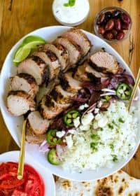 pork tenderloin sliced on a plate with rice