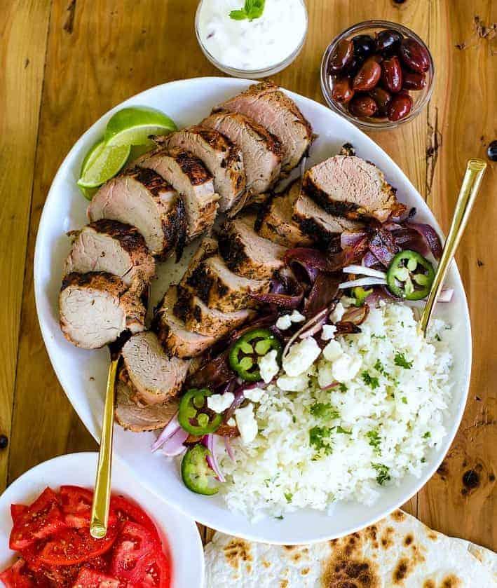 pork tenderloin sliced on a plate with rice