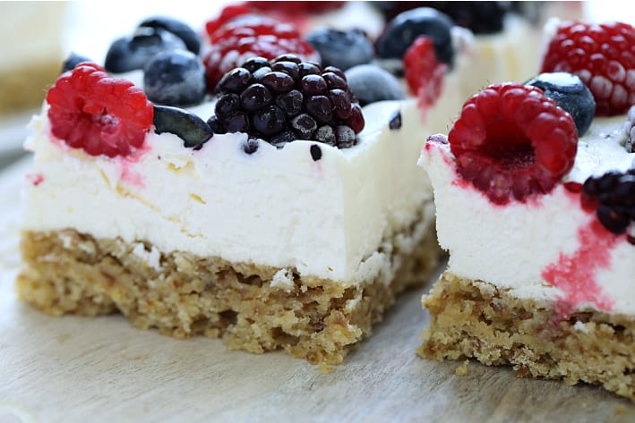 mixed berries and cream bars on a wood platter