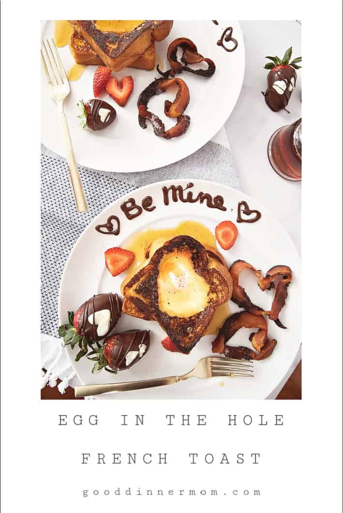 Egg in the hole french toast with heart shaped bacon and the words be mine written in chocolate on a white plate
