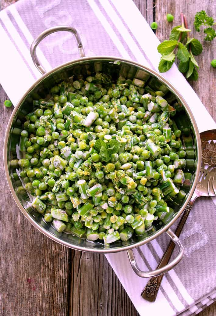 Spring Salad with Peas and Asparagus in silver serving bowl