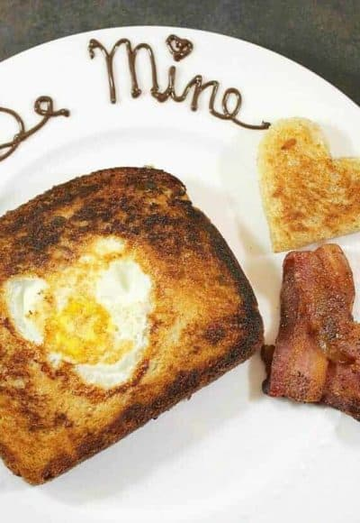 Take classic Egg In A Hole to the next level like I did when I made breakfast for my Valentine. Heart-shaped bacon is easy and fun, too!