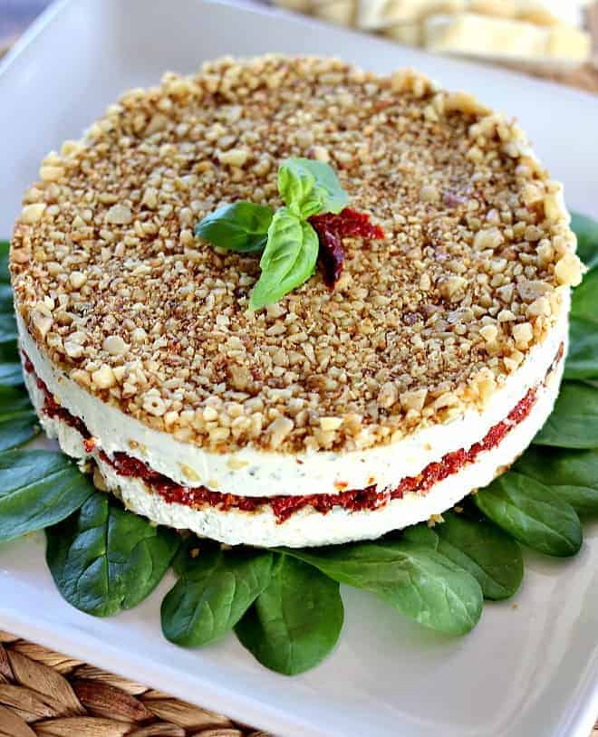 Cheese, Basil, and Sun Dried Tomato Torte is a beautiful alternative to your average party cheeseball. Can be made days ahead of serving.