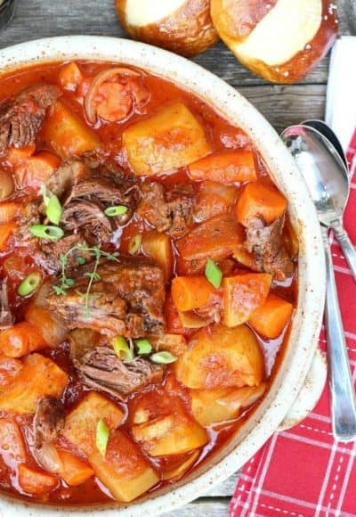 Italian Beef Stew is comfort food at its best. Chuck roast, vegetables, thyme, red wine and San Marzano tomatoes in a slow oven bring out deep, rich flavor.