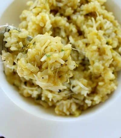 Easy Lemon Zucchini Risotto, made with tart lemons, fresh zucchini and zesty Parmesan cheese. Pairs well with salmon or chicken or as a meatless main dish.