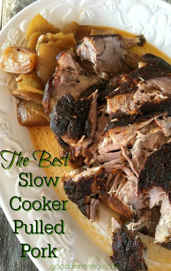 Slow Cooker Pulled Pork on a white platter with onions