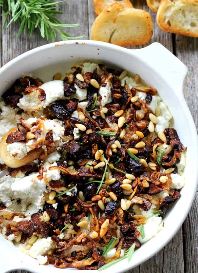 Baked Goat Cheese with caramelized onions, garlic and dried figs is an amazing appetizer with crostini or pears, and doubles as a fabulous topping for meat.