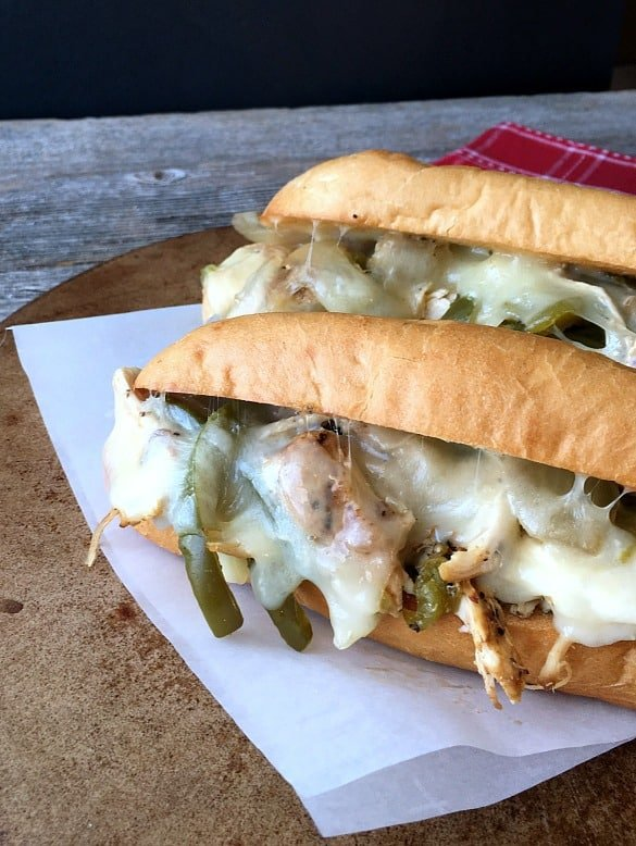 Chicken Philadelphia Cheese Steaks close up shot with cheese and peppers
