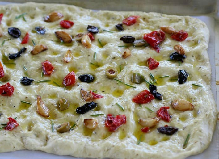 This recipe for Focaccia Bread with Olives and Rosemary is foolproof, delicious, and a great bread for beginners.