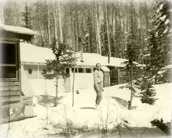Grandma out behind the family cabin on a beautiful winter day, circa 1968