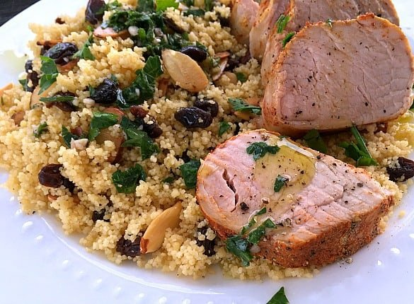 Slow cooker pork tenderloin and couscous on a plate