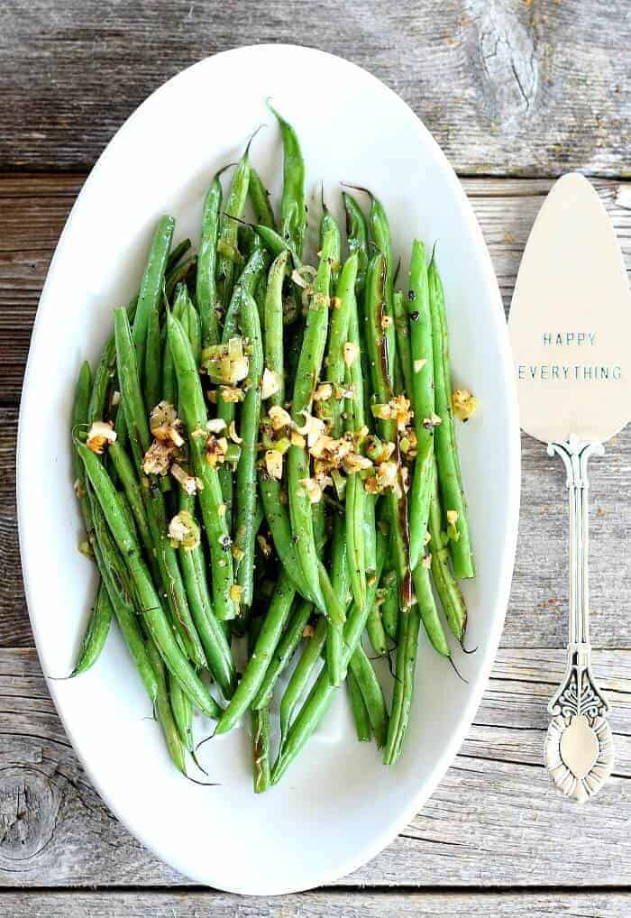 Sichuan Green Beans with scallions on a plate