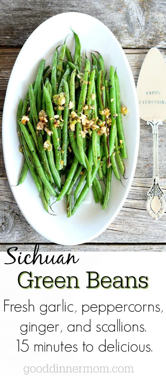 Sichuan Green Beans on a white plate with serving spoon on the side that reads Happy Everything